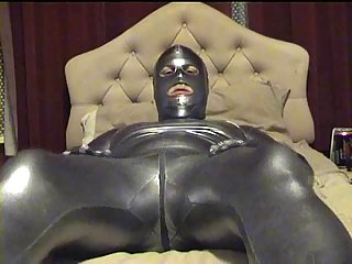 Gay In Latex Suit Yanking Pierced Dong