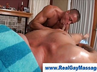 Guy watches straight guy getting a massage